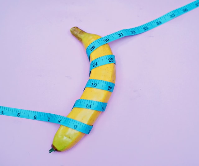 banana with measuring tape coiled around it