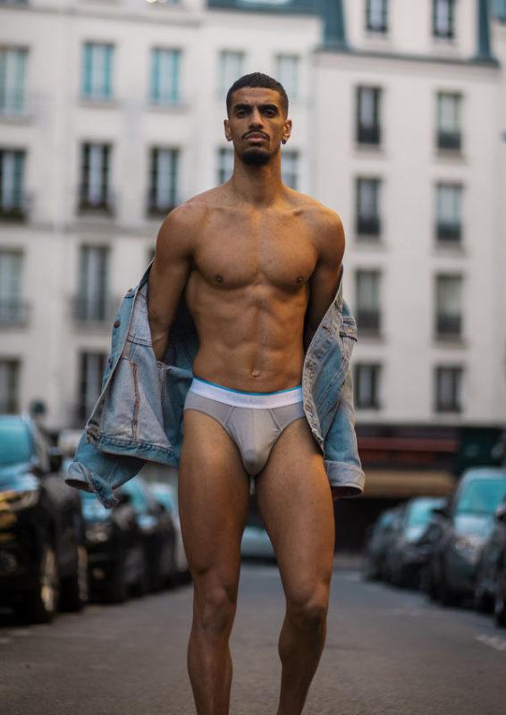 man walking up the street in calvin klein briefs